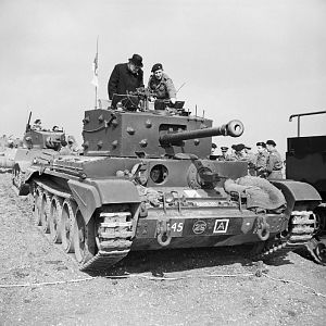 Churchill inspects a Cromwell Mk IV, 2 Sqn, 2 (Armd Recce) Bn, Welsh Guards, Pickering Yorks, 31 March 1944; IWM H 37169