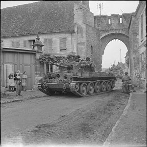 Cromwell tank of 2nd Welsh Guards, Guards Armoured Division, in Trie-Chateau, near Gisors, 31 August 1944; IWM BU 293