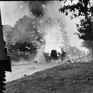 Loyd carrier of the anti-tank platoon of 3rd Battalion, Irish Guards explodes up the Eindhoven road at start of Operation 'Market-Garden', 17 September 1944