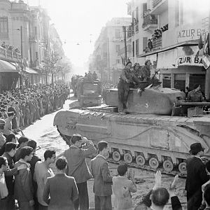 Churchill tank and other vehicles parade through Tunis, 8 May 1943; IWM NA 2880