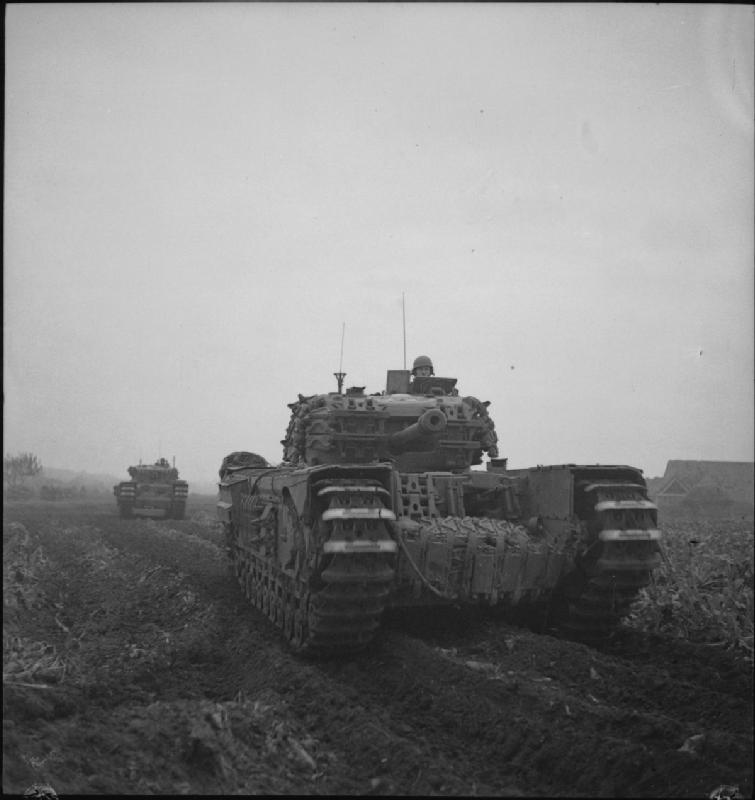 Churchill tanks of the 4th Grenadier Guards advance towards Venraij in Holland, 17 October 1944; IWM BU 1210