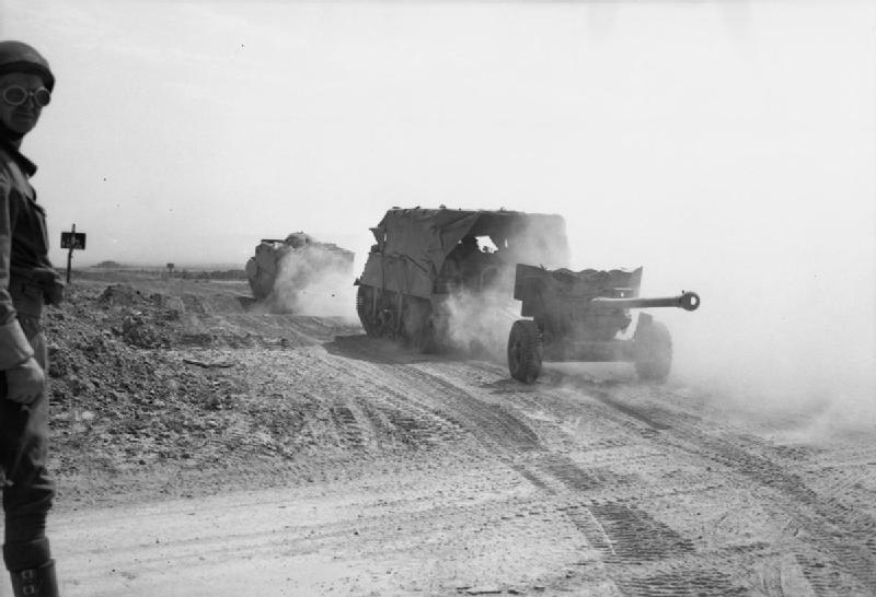 Loyd carriers and 6-pdr anti-tank guns of 3rd Irish Guards advance during Operation 'Goodwood', 18 July 1944; IWM B 7529