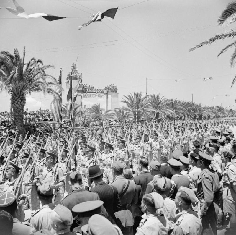 Scots Guards march past during the Victory Parade in Tunis; IWM NA 3016