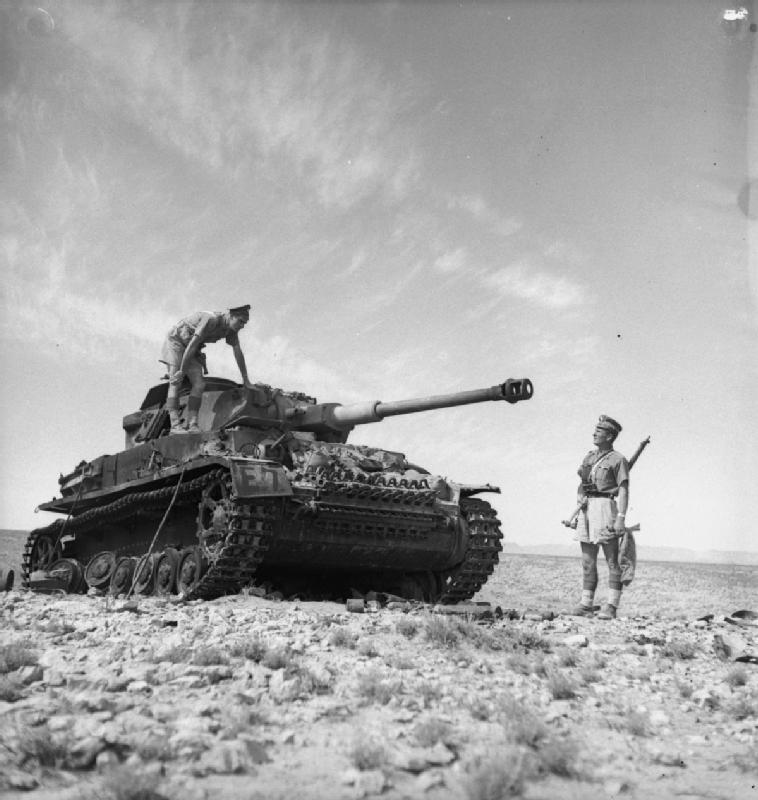 Scots Guardsmen inspect a knocked-out German PzKpfw IV tank near Medenine, 12 March 1943; IWM NA 1106