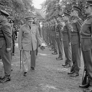 Prime Minister Winston Churchill inspecting a guard of honour of the Scots Guards at British Headquarters, Berlin; IWM BU 8888