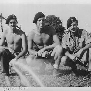 Lt Miles,25th Dragoons with unidentified comrades,Arakan Burma 1944 outside Lee Grant tank harbour.